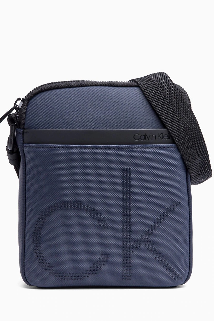 Calvin Klein tmavo modrá pánska crossbody taška CK Point Mini Report ... 2f0619e4cdf